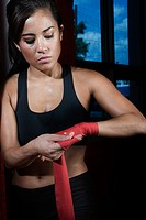 Female boxer wrapping hands (thumbnail)