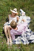 Couple on a blanket in a field (thumbnail)