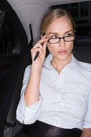 Businesswoman adjusting her eyeglasses