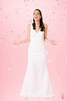 Bride standing beneath falling confetti (thumbnail)