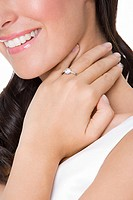 Smiling woman wearing an engagement ring