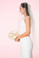 Side view of a bride holding a bouquet