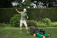 Man struggling with a lawn mower