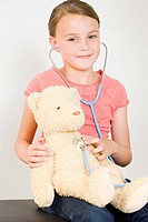 Girl with teddy bear and stethoscope (thumbnail)