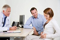 Expectant couple visiting doctor