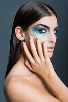 Woman with blue glitter eye makeup
