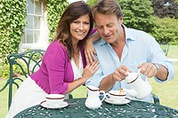 Couple having tea outdoors