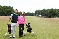 Golfing couple on the fairway