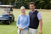 Golfing couple on the fairway (thumbnail)