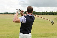 Rear view of a male golfer