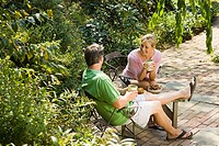 Couple having drink in garden