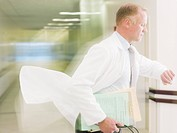 Doctor rushing in hospital corridor
