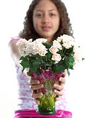 Girl holding vase with roses