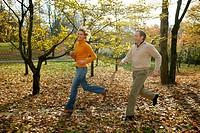 couple running in autumn