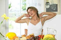woman having breakfast streching herself