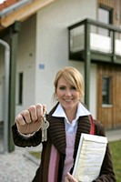 female estate agent at hand over of keys to the new house