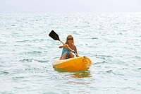 sexy woman have fun with sea kayak