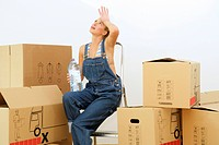 Young Woman Moving Boxes of Belongings Into New Home