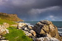 Stormy skies over Fair Head on the Causeway Coast, County Antrim, Ulster, Northern Ireland, United Kingdom, Europe