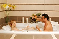 Young couple in bath tub having romantic time