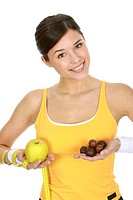 Young woman in sport jerseys with fruits and chocolates