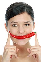 Young woman with chilli