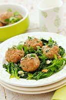 Meatballs with herbs on spinach