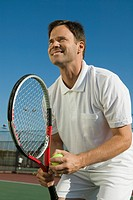 Male Tennis Player Preparing to Serve low angle view