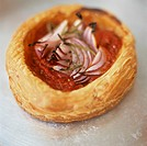Tomato and onion puff pastry tart