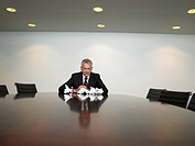 Stressed businessman in conference room