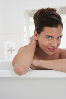 Woman relaxing in bathtub portrait