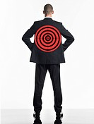 Young businessman with target on back back view