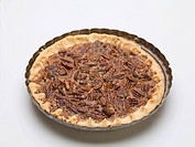 Whole pecan pie in the baking dish