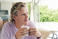 Man having coffee in living room