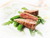 Lamb fillet on sugar snap peas