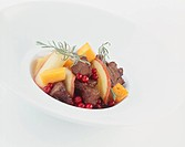 Braised shoulder of venison with cranberries & sweet potatoes