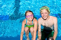 Young brother and sister in swimming pool