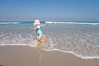 Girl 1-3 playing in waves on beach (thumbnail)
