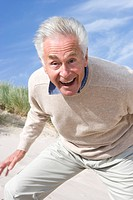 Portrait of senior man shouting on beach (thumbnail)