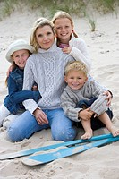 Portrait of mother and children on beach