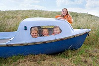 Portrait of young children in boat