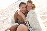 Young women hugging on beach