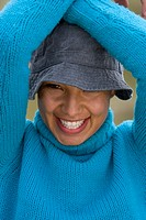 Portrait of young happy woman in hat, close_up