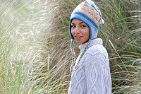 Portrait of young mixed race woman in hat outdoors