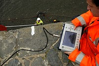 Workers using ground penetrating radar to assess the strength of Aberaeron harbour wall, Wales