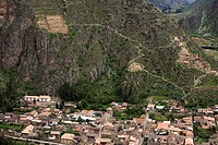 Village of Ollantaytambo, with ancient ruins on mountain slope, Province of Urubamba, Cusco region, Peru