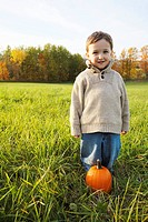 Artist´s Choice: Young boy playing with pumpkin, Stayner, Ontario