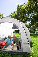 Couple looking at map in tent