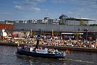 Berlin beach near Lehrter main station, riverbank Spree, Tour boat people