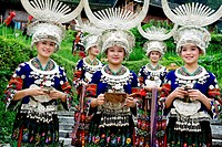 Miao young women in Miao traditional costume welcomes tourists with wine, Leishan County, Kaili City, Qiandongnan Miao and Dong Autonomous Prefecture,...